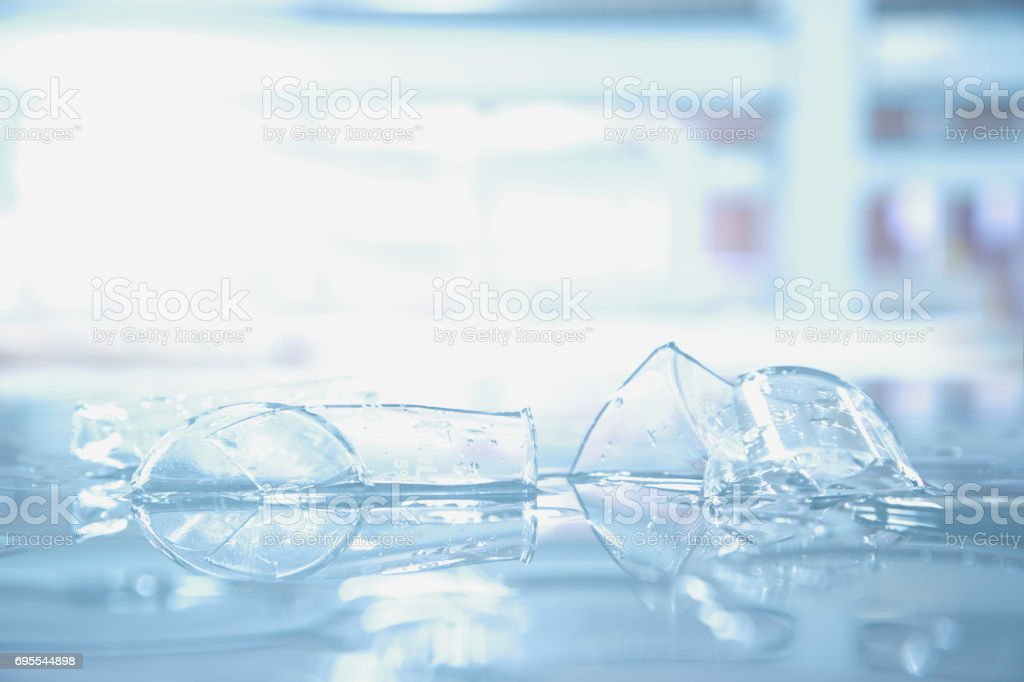 broken beaker glass in science laboratory stock photo