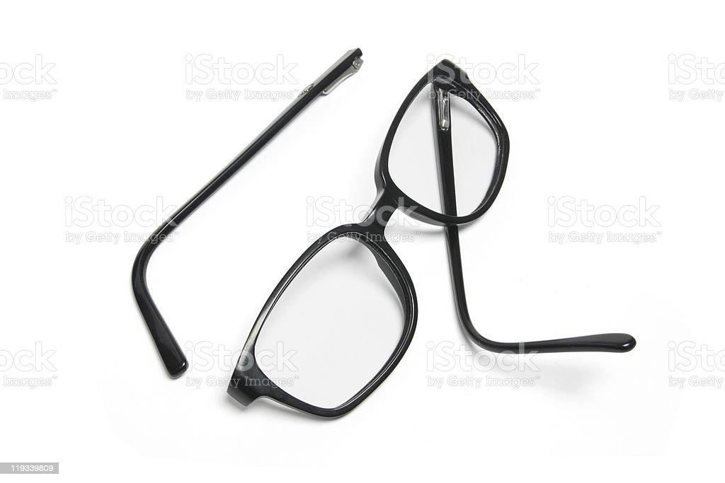 Broken black eyeglasses on a white background stock photo
