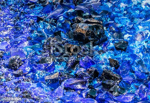 Italy,10 September 2018,abstract background broken glass, pieces of blue glass with solar light reflection