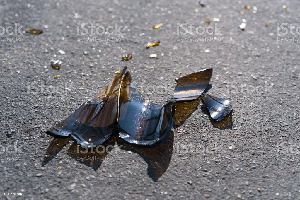 Broken bottle on the asphalt stock photo