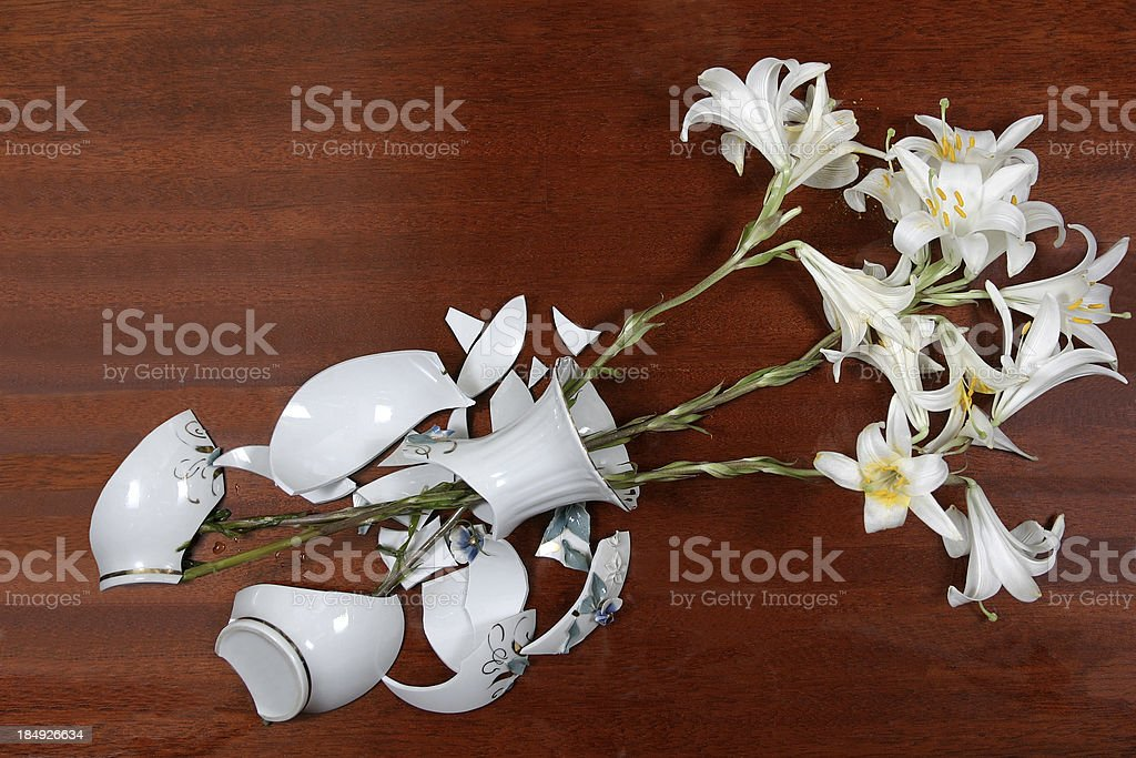 Broken bowl with flowers stock photo
