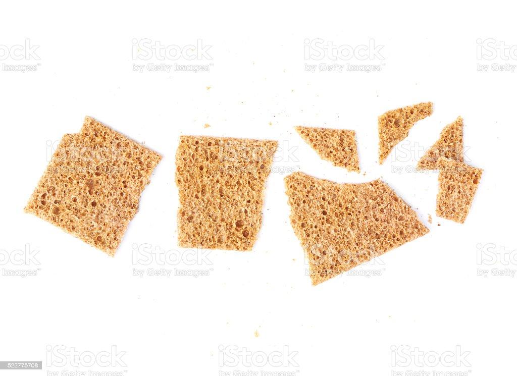 Broken bread cracker snack isolated stock photo