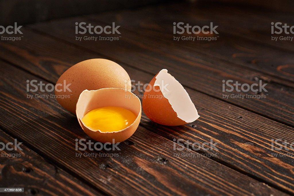Broken brown egg stock photo