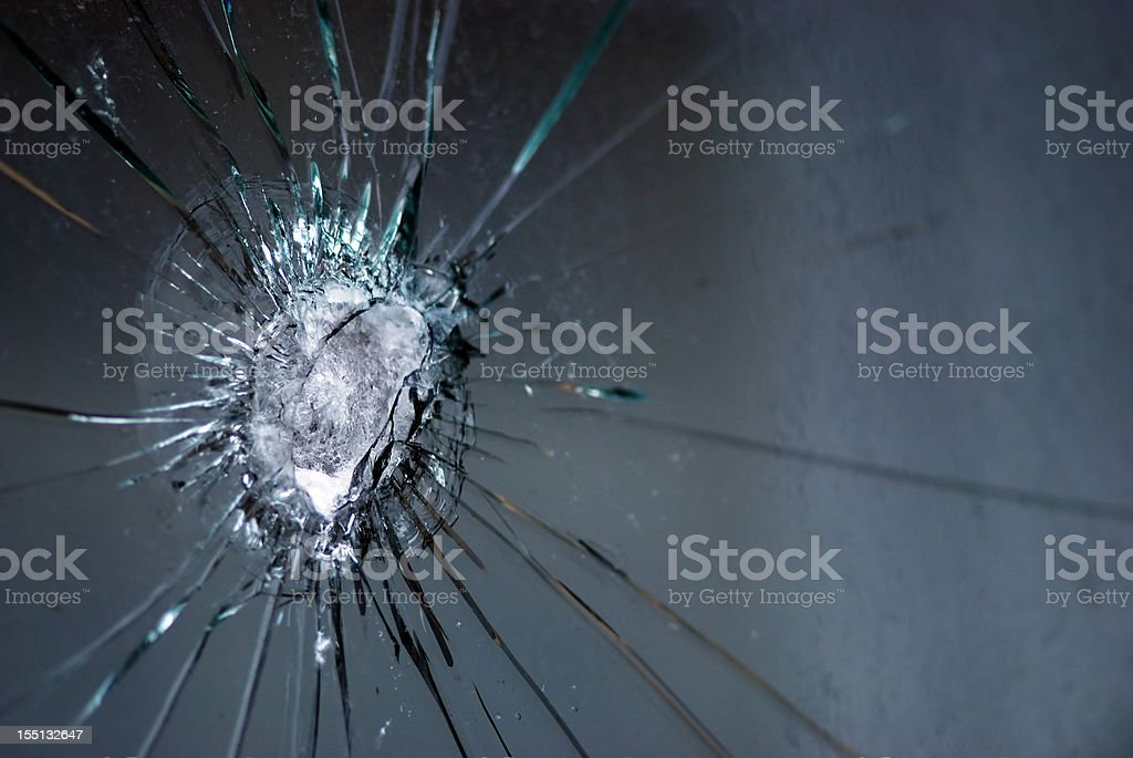 Broken bulletproof glass stock photo