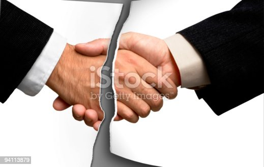 94113879istockphoto Broken business handshake 94113879