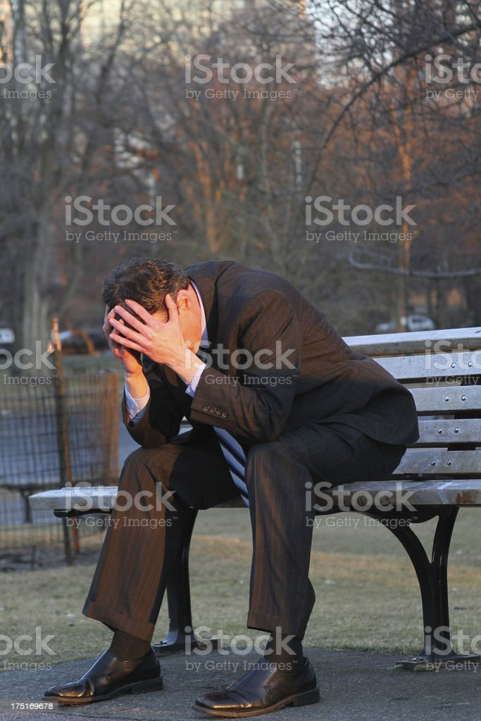 Broken businessman on bench royalty-free stock photo