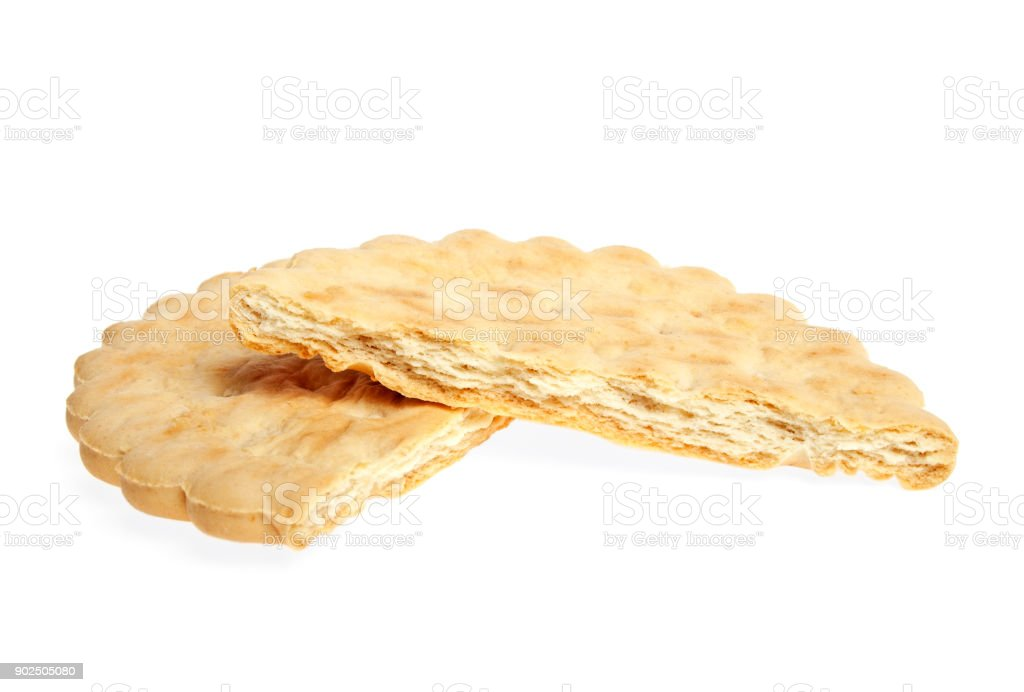 Broken butter biscuits on a white background stock photo
