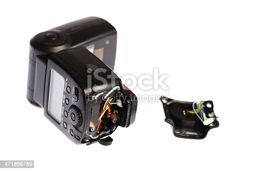 Picture of a broken external photo camera flash isolated on white