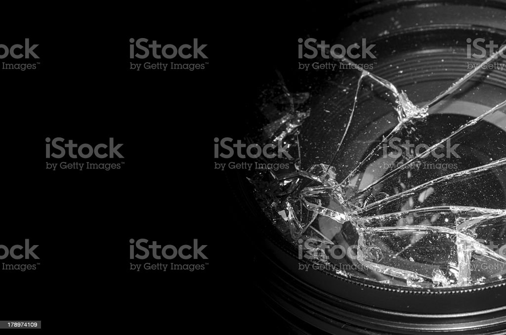 Broken camera lens stock photo
