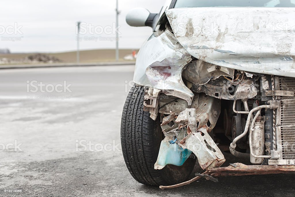 broken car after the accident in  foreground stock photo