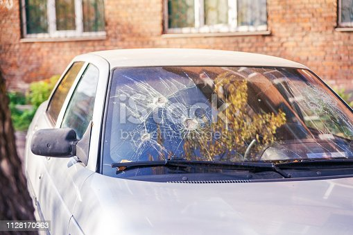 istock Broken car glass. Few blows to glass 1128170963
