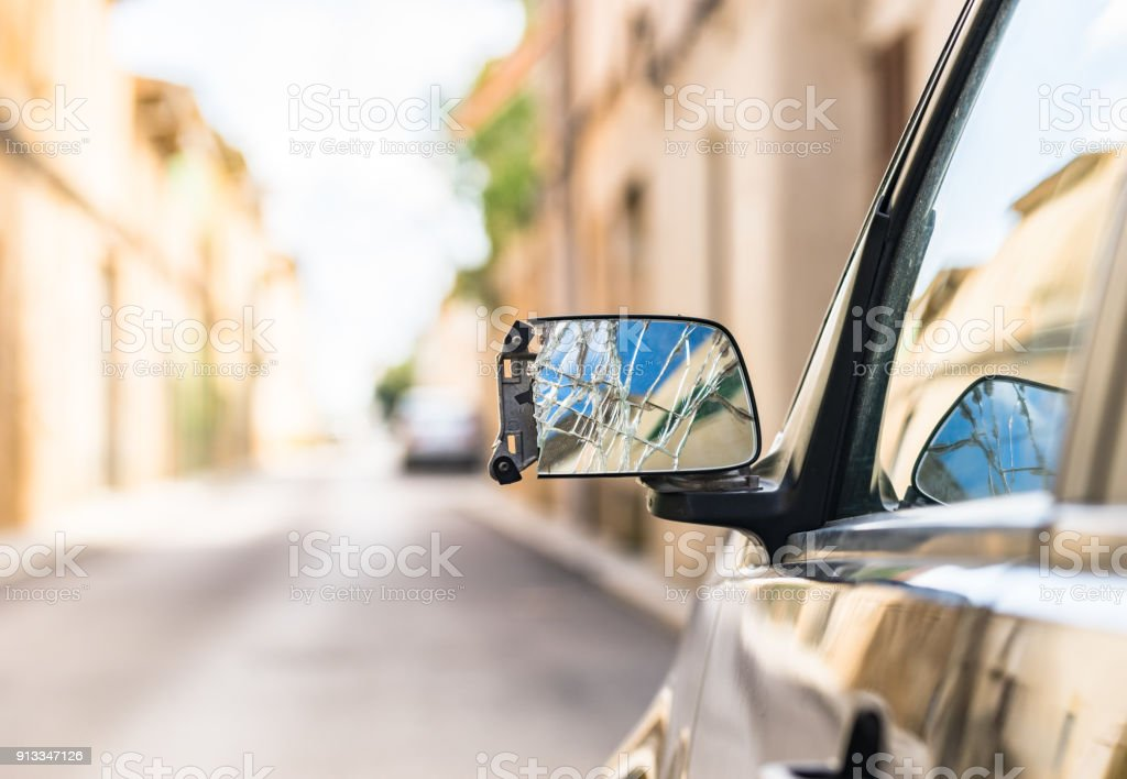 Broken car mirror stock photo