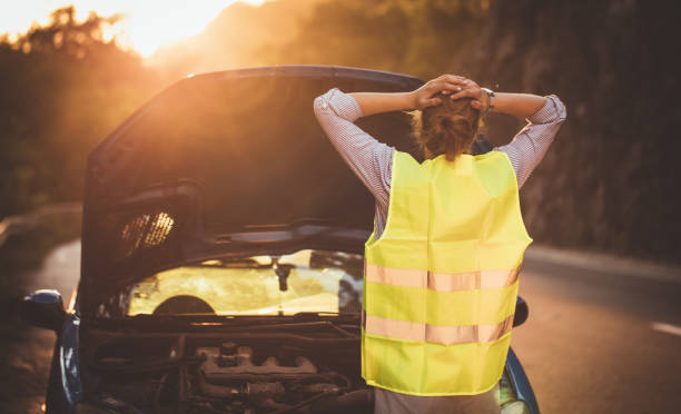 broken car on the road - impaired driving stock photos and pictures