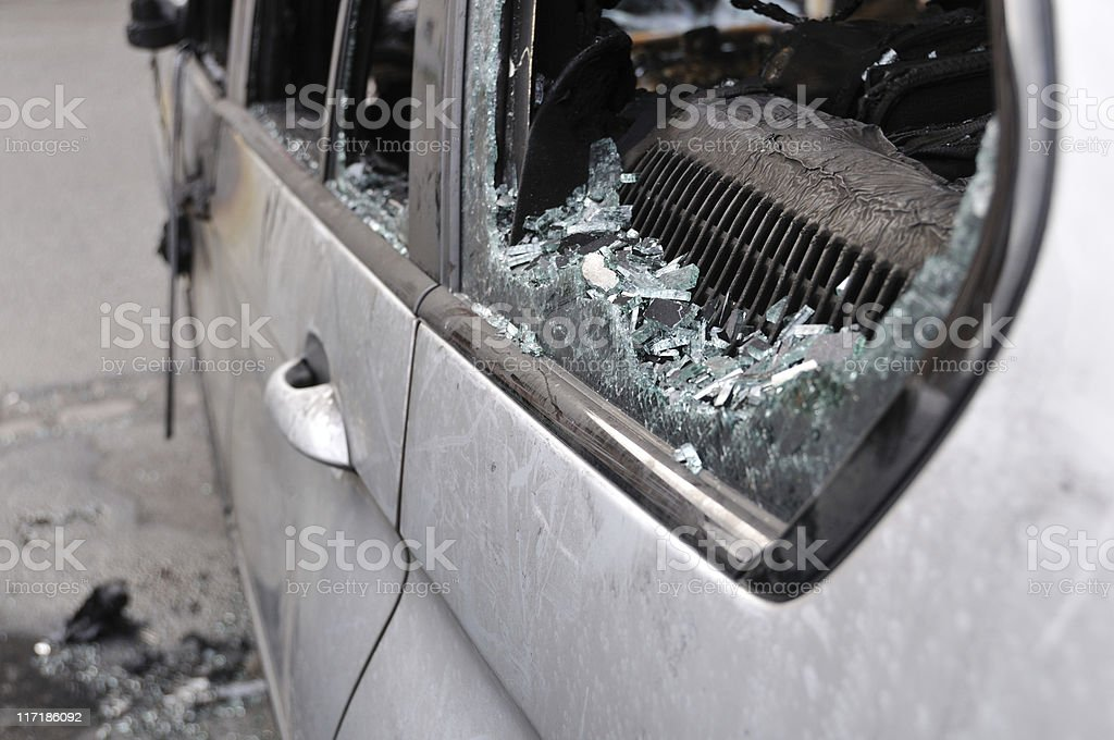 Broken car window with lots of glass pieces royalty-free stock photo