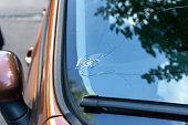 istock Broken car windshield glass from stone 1254785008