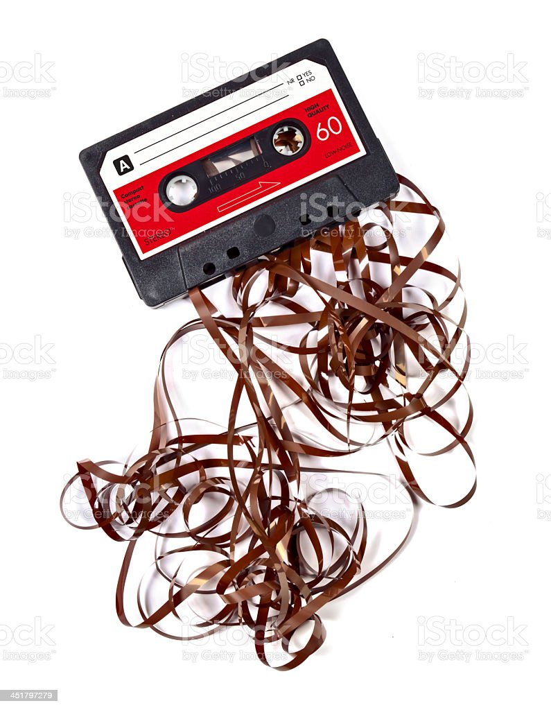 Broken cassette tape on a white background stock photo