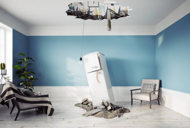 broken ceiling and falling refrigerator stock photo