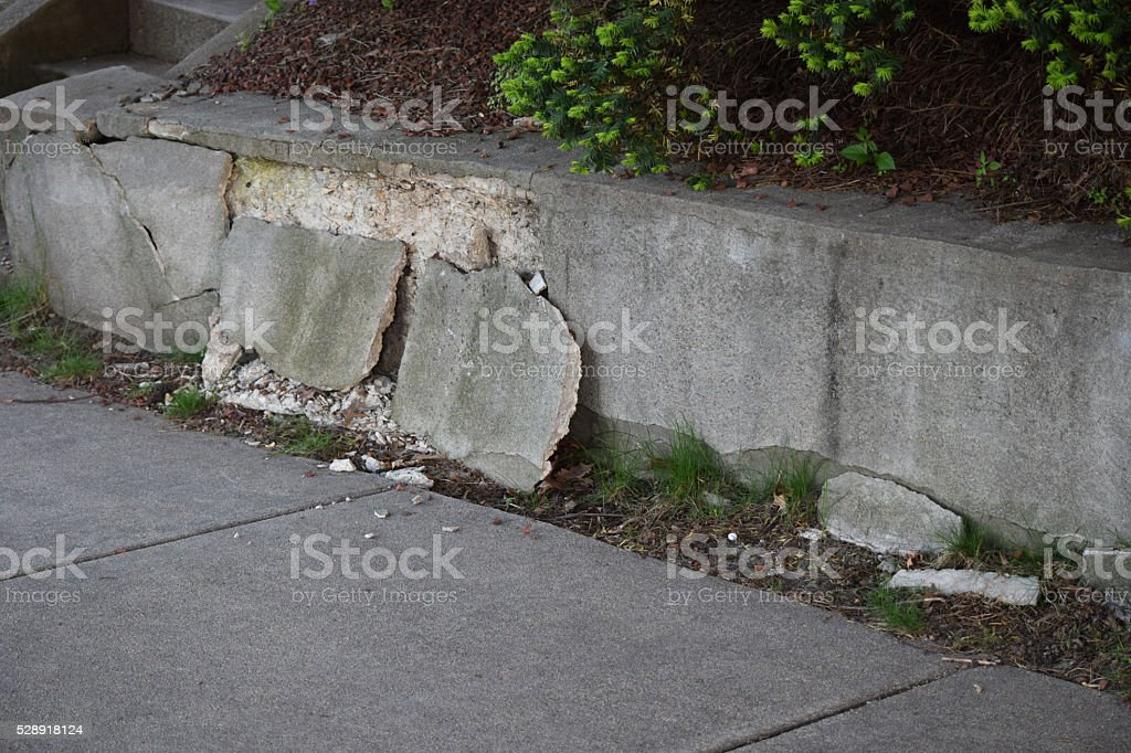Broken cement retaining wall stock photo