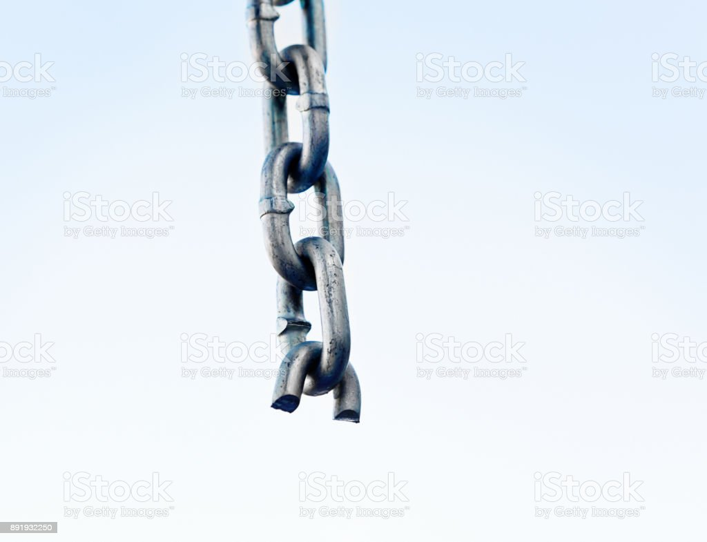 Broken chain with link snapped stock photo