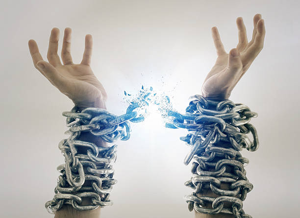 Broken chains stock photo