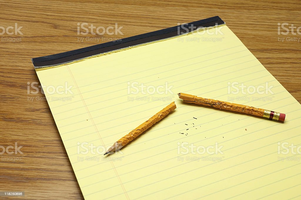 Broken Chewed Pencil On Notepad stock photo