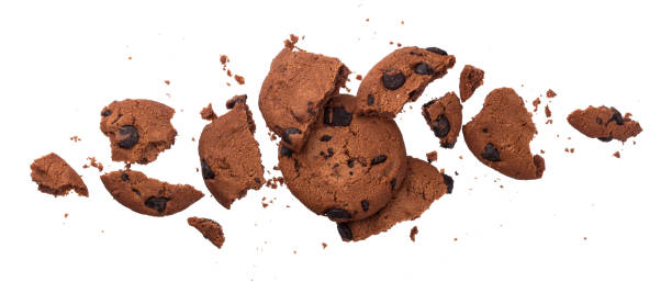 gebrochen schokoladenkekse isoliert auf weißem hintergrund - hafer cookies stock-fotos und bilder