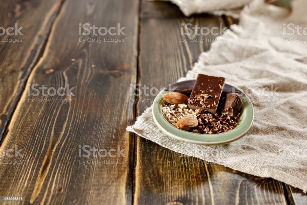 Broken chocolate pieces in a small Cup stock photo