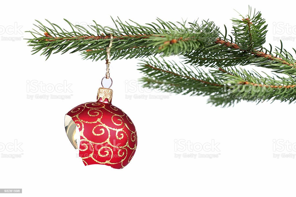 Broken Christmas decoration hanging on a tree stock photo