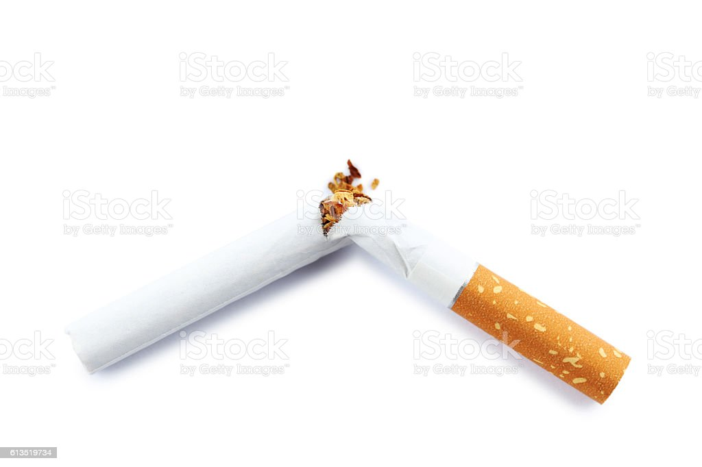Broken cigarette isolated on a white stock photo