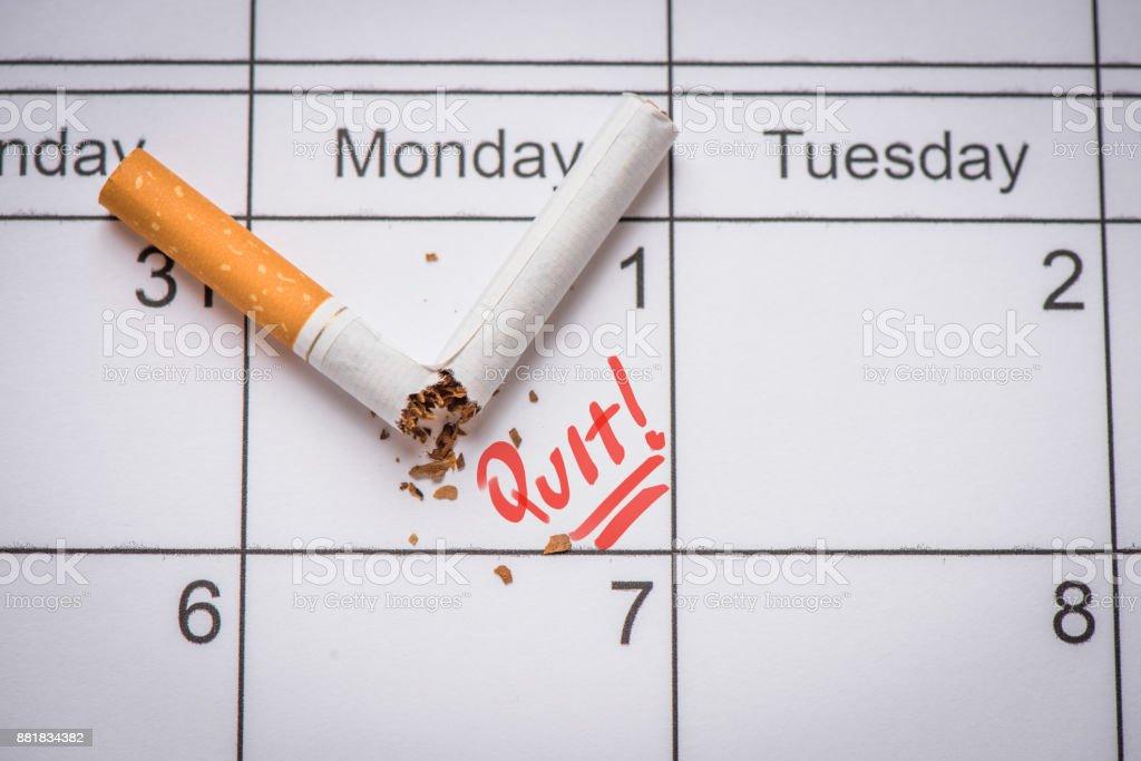 Broken Cigarette On Calendar Time To Quit Smoking Concept