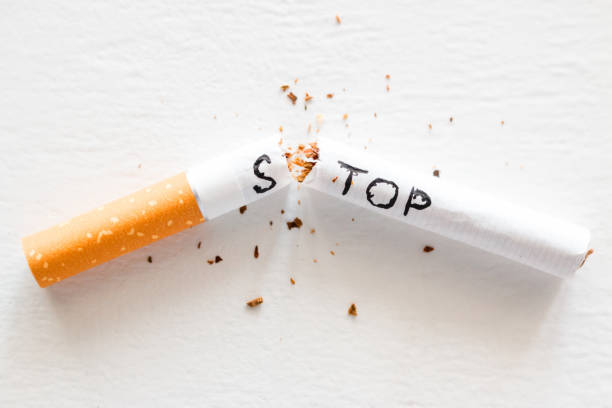 broken cigarette with the word stop. stop smoking concept closeup broken cigarette with the word stop. stop smoking concept closeup nicotine stock pictures, royalty-free photos & images