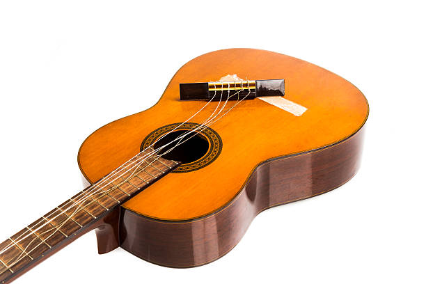 broken classical guitar with detached bridge isolated in white b - broken guitar stock photos and pictures