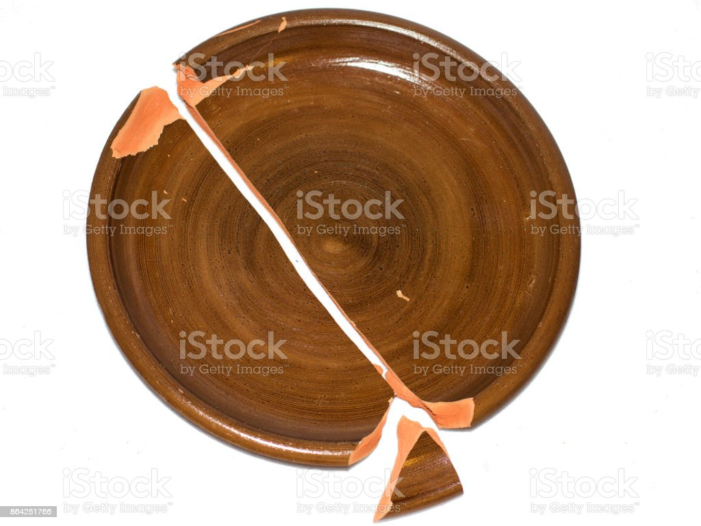 Broken clay dish. Isolated on the white background royalty-free stock photo