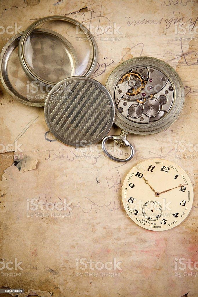 Broken clockwork on grunge paper royalty-free stock photo
