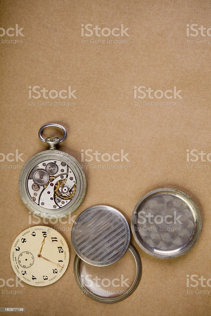 Broken clockwork on grunge paper royalty-free stock photo