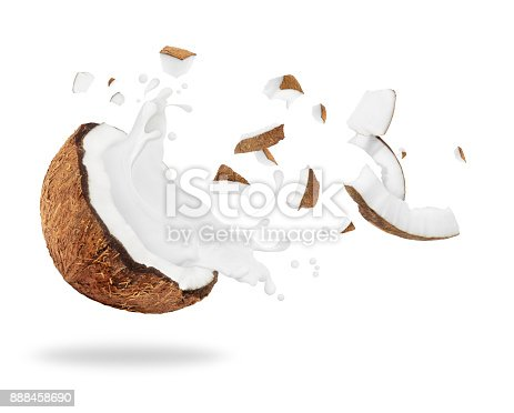 istock Broken coconut with milk splash, isolated on white background 888458690
