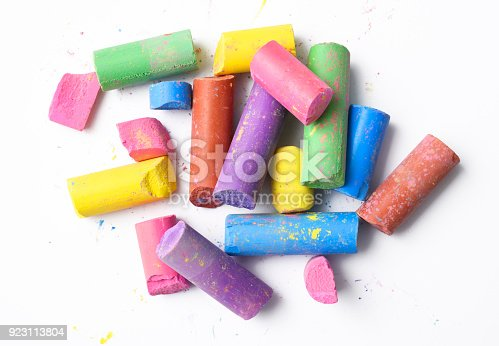 Broken colorful chalks isolated on white with clipping path.
