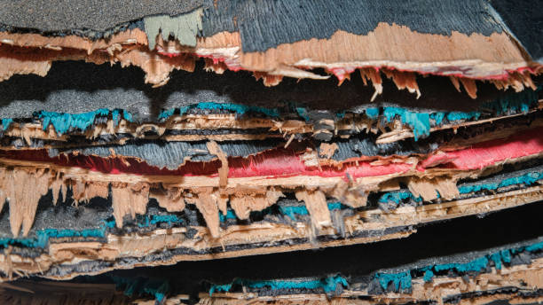 Broken colourful skateboard decks stacked on top of each other, skateboard recycling stock photo