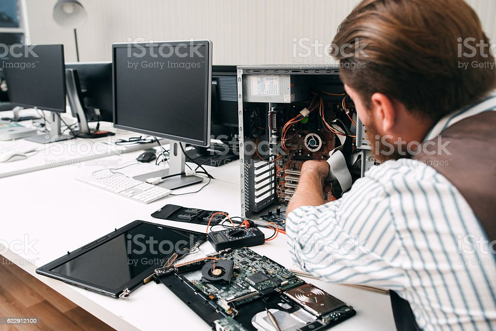 Broken computer disassembling, close-up stock photo