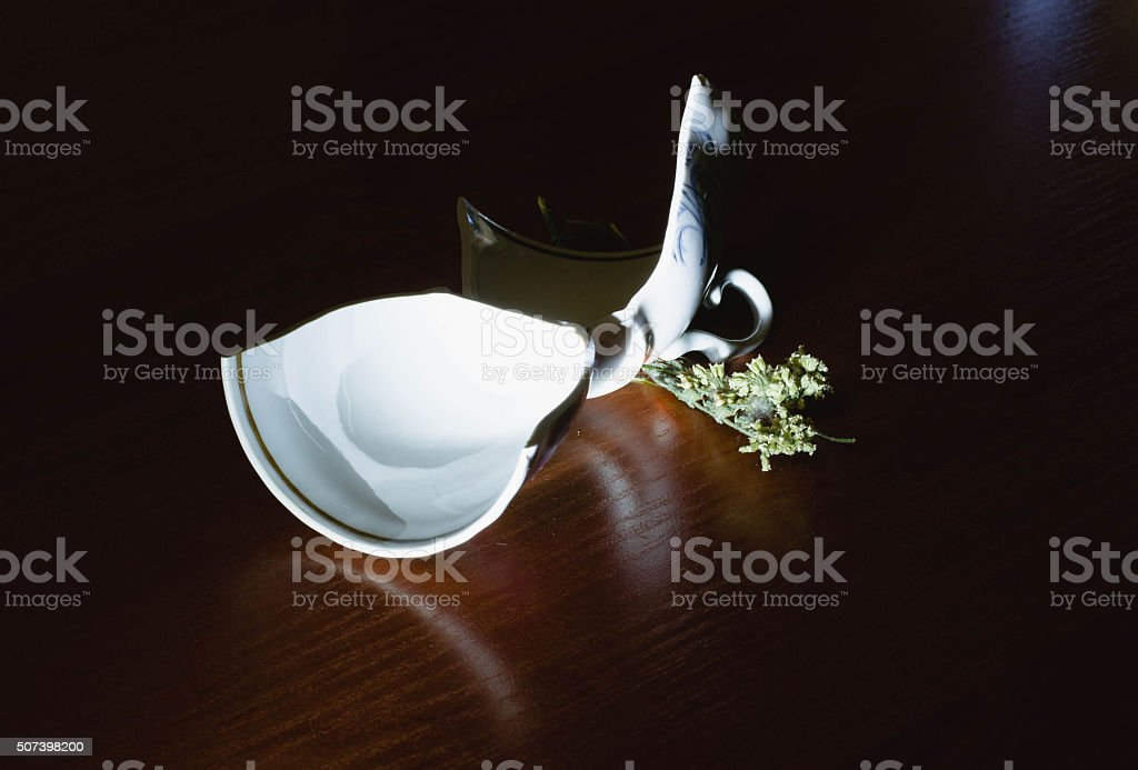 broken cup in a low key stock photo