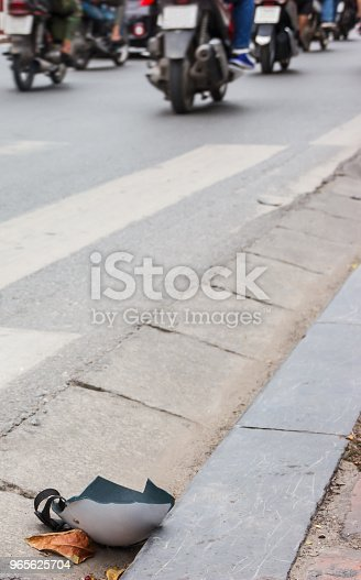 508966965 istock photo broken damaged helmet on the road. car, bike crash, accident, loss and insurance, hospital call concept. 965625704