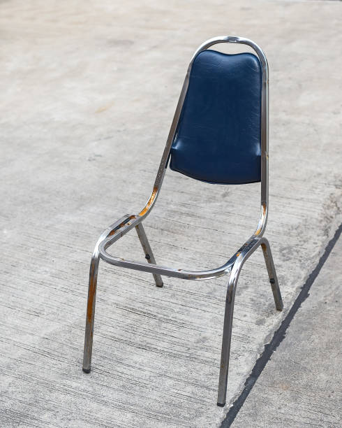 Broken dead leather blue chair. stock photo