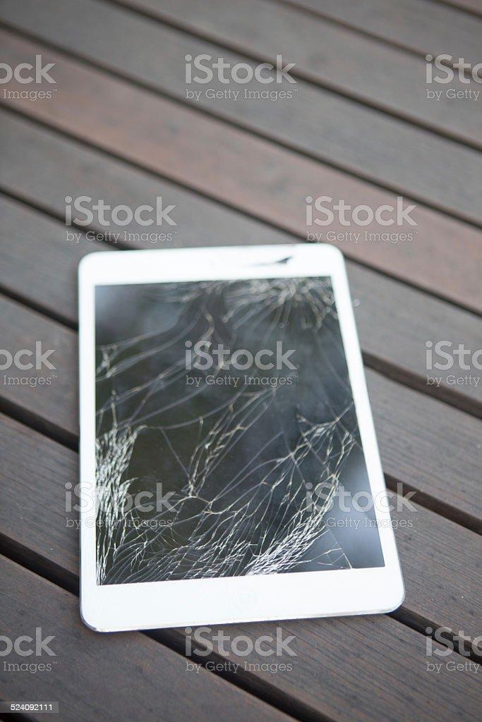 Broken digital tablet stock photo