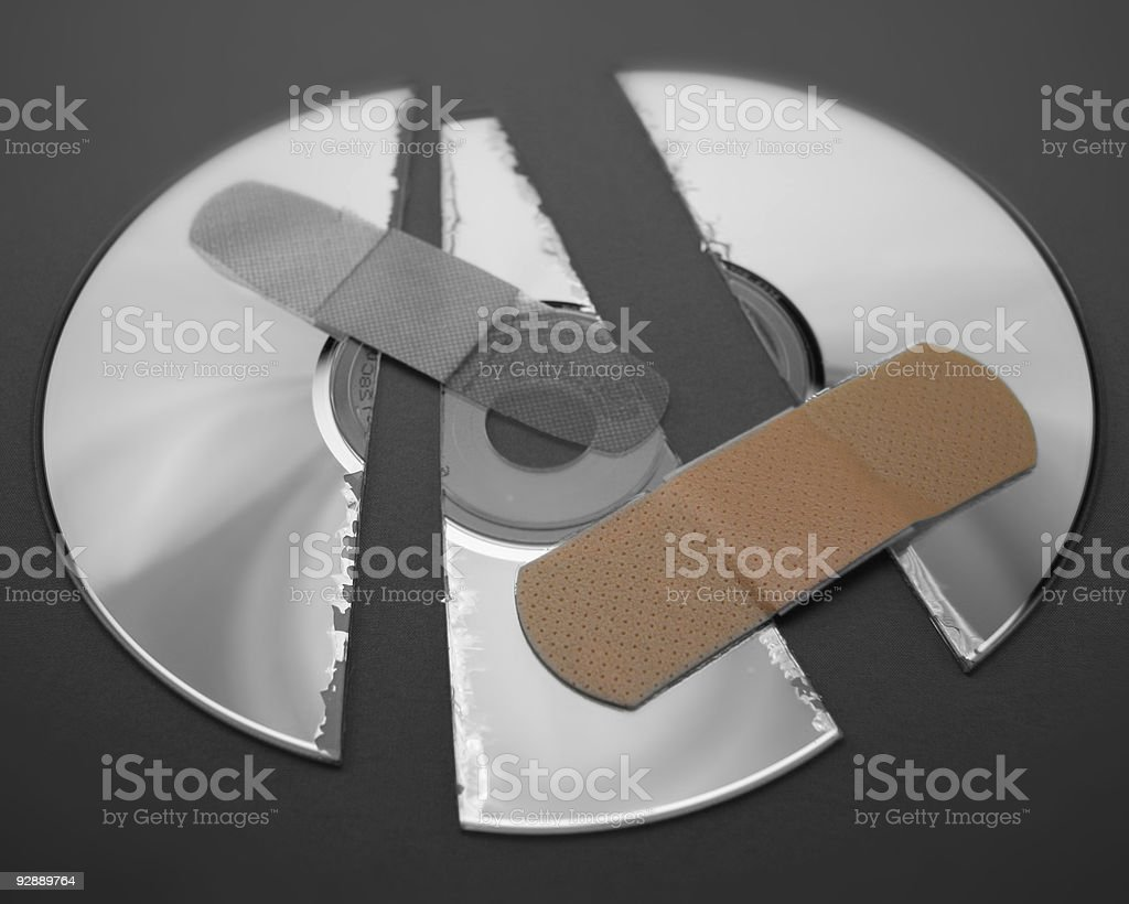 Broken Disk with bandage. stock photo