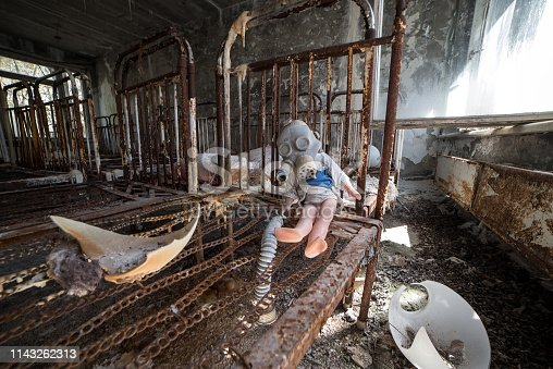 istock Broken doll in Chernobyl and Pripyat school and kindergarten. Left after nuclear power plant disaster. The exclusion zone, Ukraine 1143262313