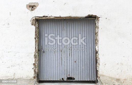 826150670istockphoto Broken door metal 696445958