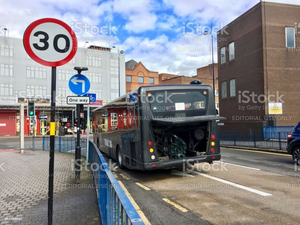 Broken down bus on a city street - UK royalty-free stock photo