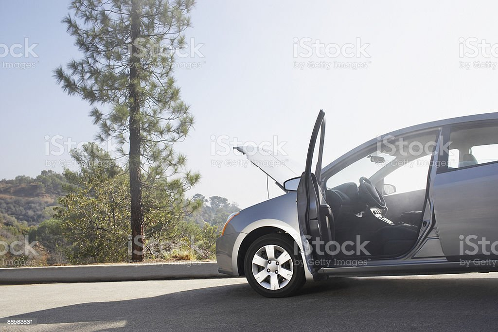 Broken down car on side of road stock photo