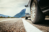 Close up of a car standing on a breakdown lane, summer vacation