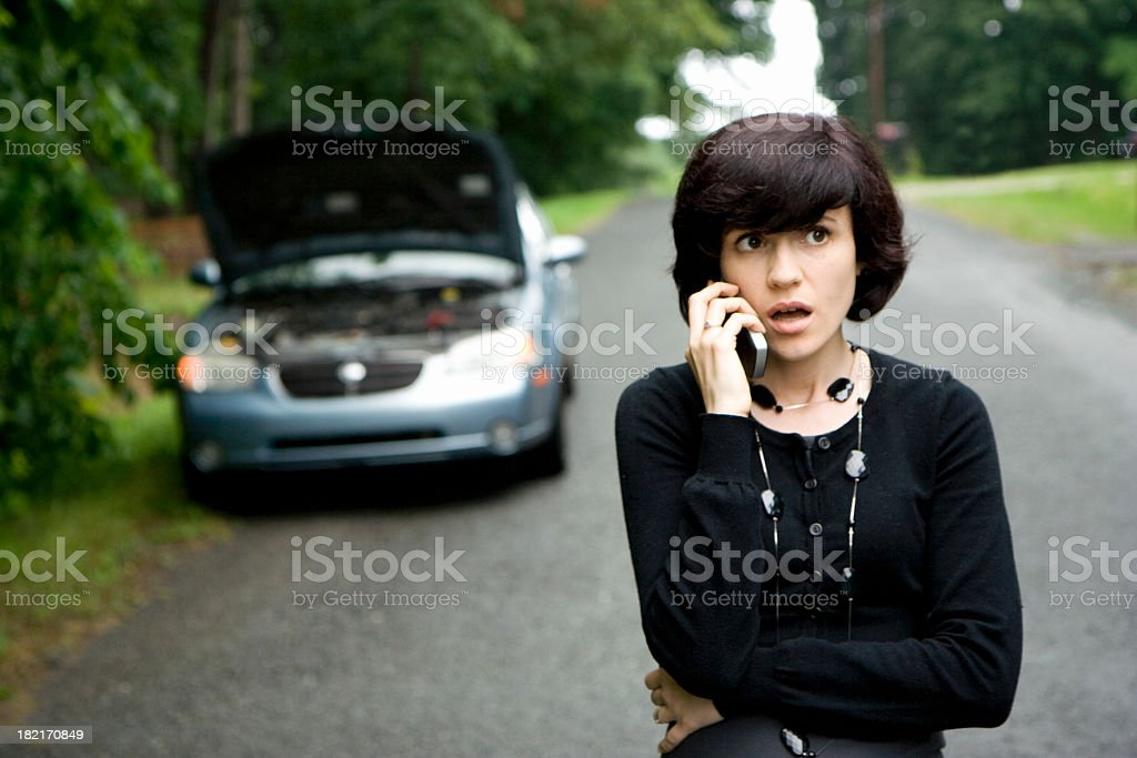 Broken down talking on cell phone stock photo